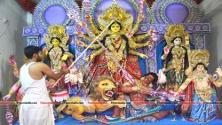 A priest performing eye-sight ritual on Devi Durga's idol to mark the auspicious occasion of Mahalaya