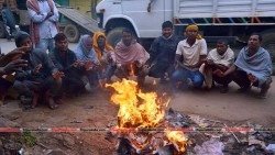 City people sitting round the fire in order to prevent the shaggy winter at the city